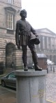Photograph of the new statue of the firemaster James Braidwood.  Statue located in Parlament Square (near The Royal Mile) in the city of Edinburgh, UK.