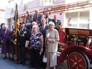 Guests at the service photographer with the vintage fire engine