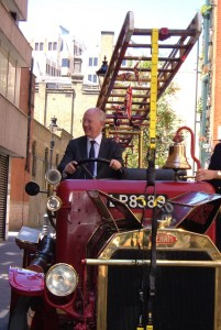 The minister, Philip Majcher, driving the vintage fire engine.