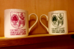 Red and green Crown Court mugs