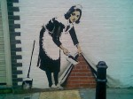 Street graffiti of a cleaning lady