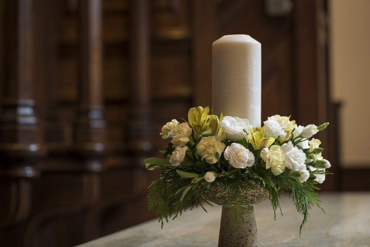 Image of a candleon the communion table in Crown Court Church sanctuary